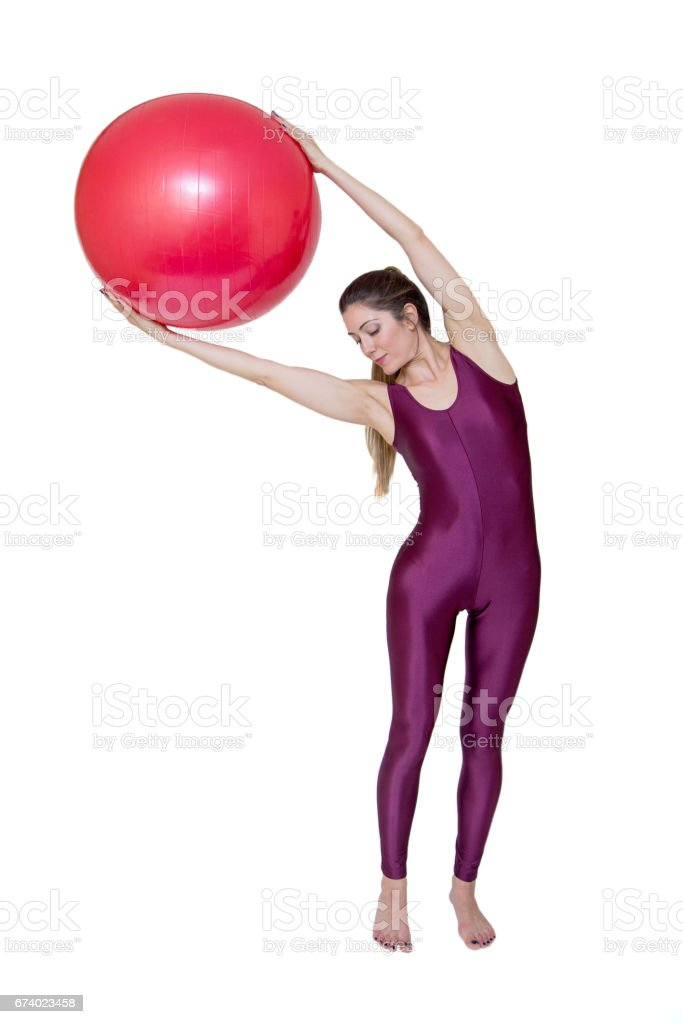 Young woman exercise with red pilates ball isolated on white royalty-free stock photo