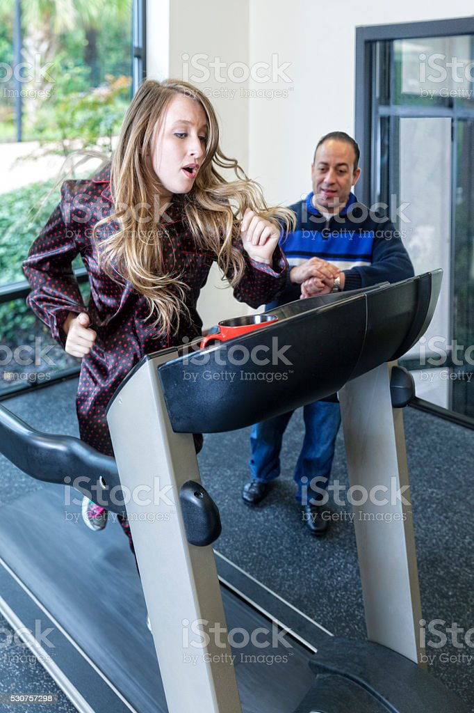 Young Woman Exercises with Her Training Coach stock photo