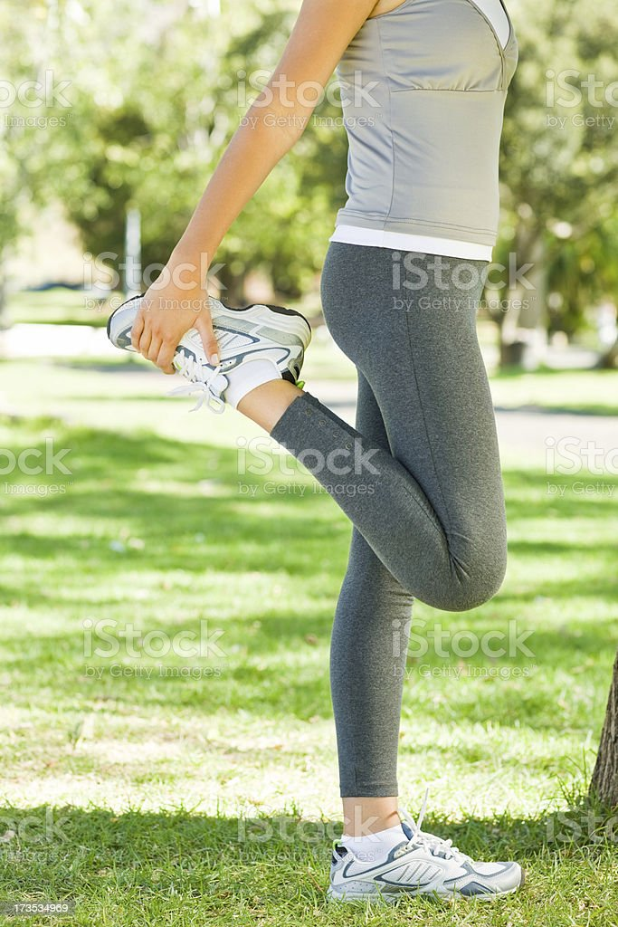 Young woman exercising at park royalty-free stock photo