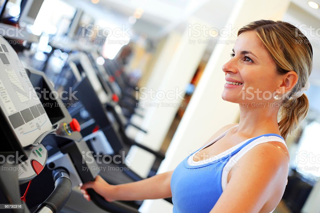 Young woman exercising in a fitness center. royalty-free stock photo