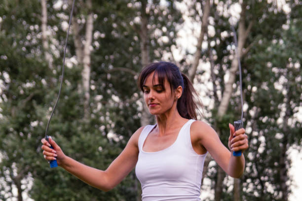 Young woman exercising in nature stock photo
