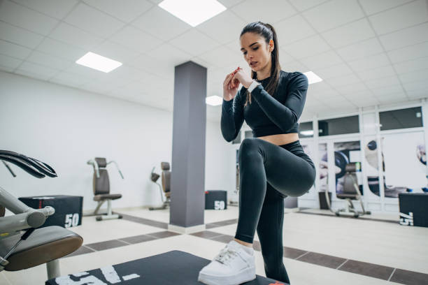 Young woman exercising on step aerobics equipment stock photo