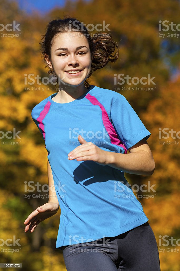 Young woman exercising outdoor royalty-free stock photo