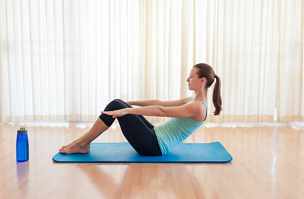 young woman exercising (sit-ups exercise) - sit ups stock photos and pictures