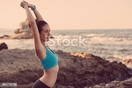 816941230istockphoto Young woman exercising 654715766