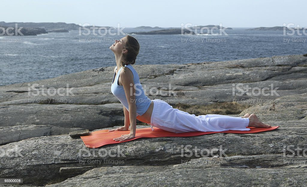 young woman exercising power yoga stock photo