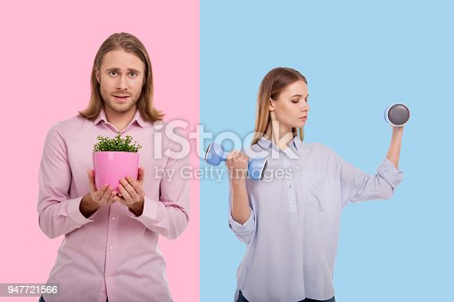 istock Young woman exercising with dumbbells and man holding flower pot 947721566