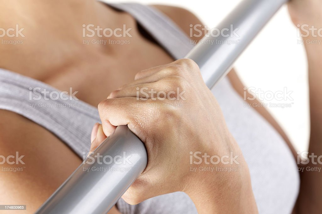Young woman exercising with metal bar royalty-free stock photo