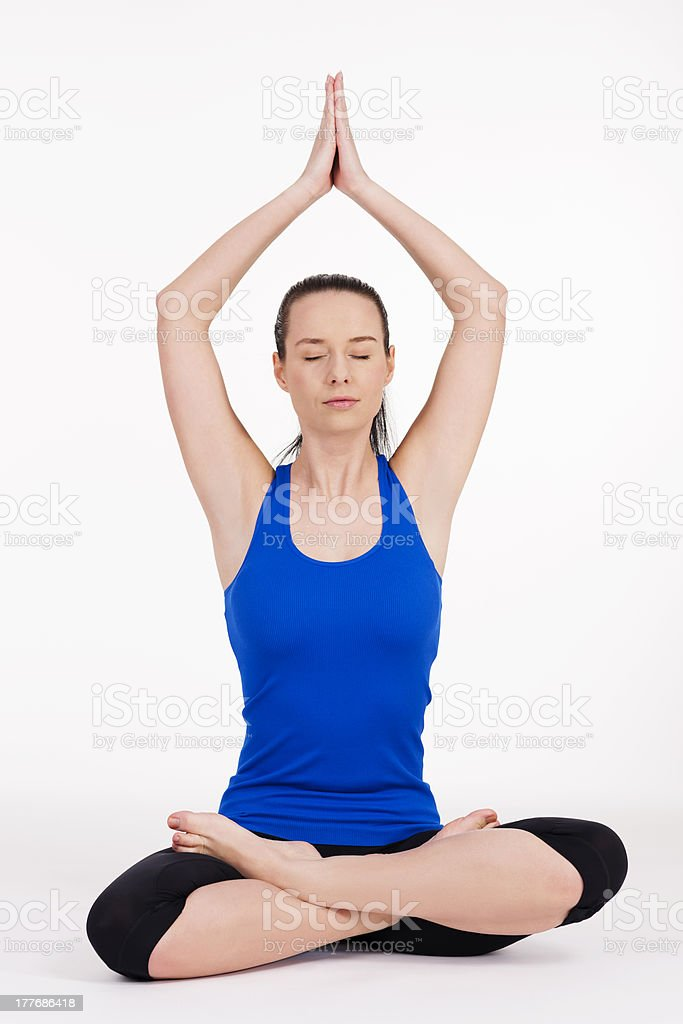 Young woman exercising yoga royalty-free stock photo