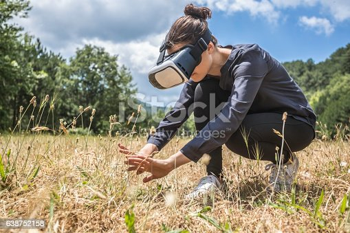 Young woman experiencing virtual reality of nature