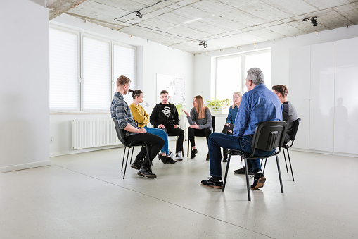 Young Woman Explaining During Mental Group Therapy Stock Photo - Download Image Now