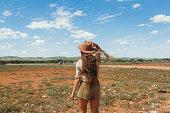 istock Young woman explorer having safari trip looking at zebra in Etosha National Park, Namibia 1323678239