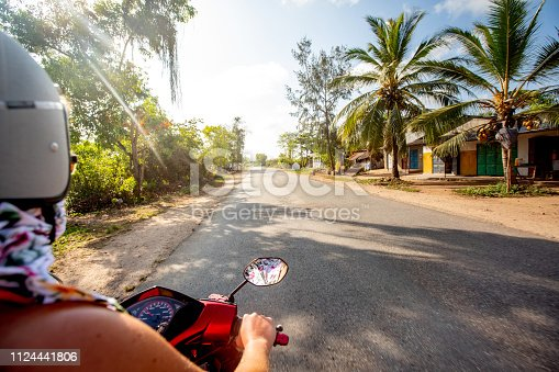 istock Young Woman Exploring Africa With Rental Motor Scooter 1124441806