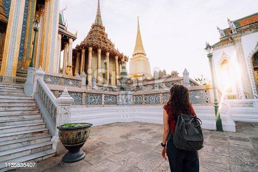 Young woman exploring Grand Palace and Wat Phra Kaew in Bangkok, Thailand