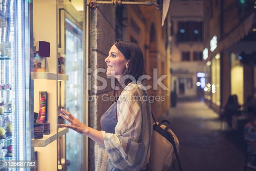 Young woman exploring local stores in Verona, Italy