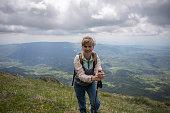 istock Young woman exploring mountain 1255386989