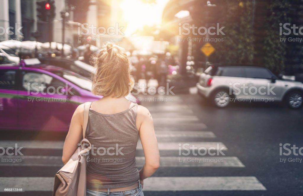 Young woman exploring streets of Bangkok stock photo