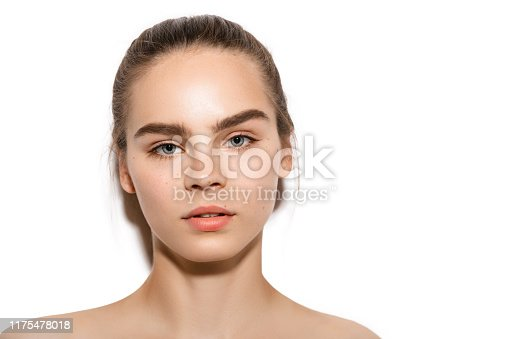 Young woman face portrait with brown hair, clean skin and beautiful natural thick,eyebrows. Skin care,Beauty treatment and spa concept.