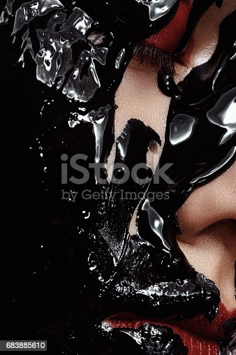 istock Young Woman Face with black Makeup 683885610