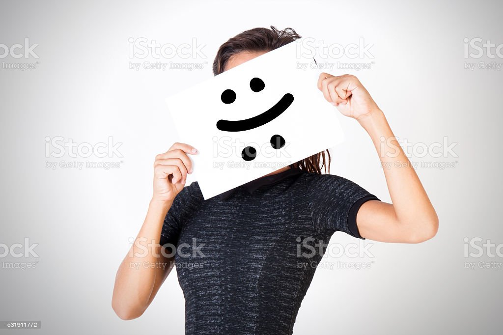 Young woman facing bipolar disorder - happy & sad stock photo
