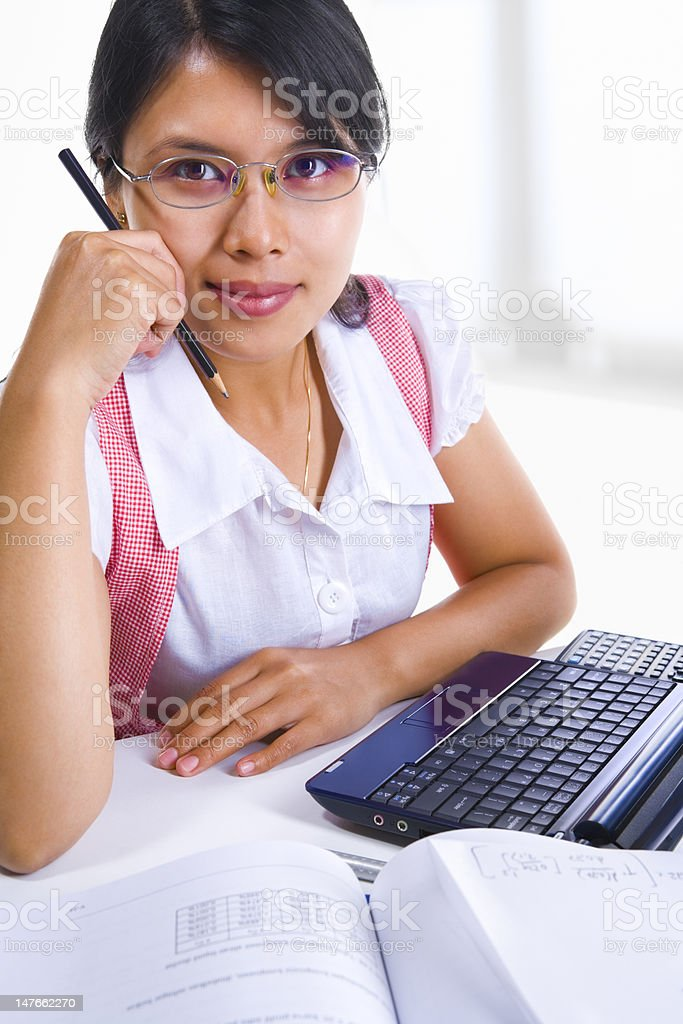 Young woman facing camera in class royalty-free stock photo