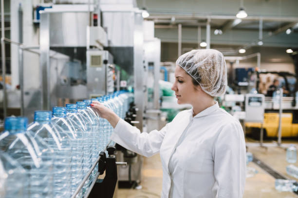 young woman factory worker - bottling plant stock photos and pictures