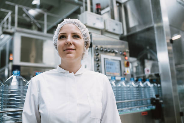 Young woman factory worker stock photo