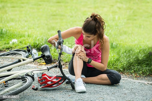istock Young Woman Fallen From Bicycle 860848822