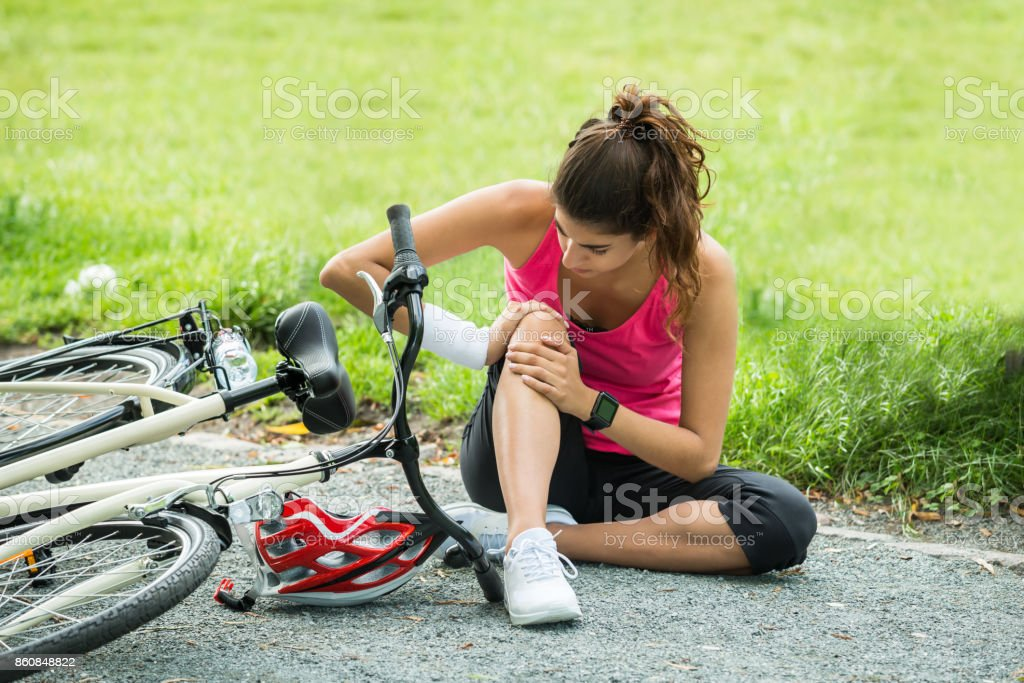 Young Woman Fallen From Bicycle stock photo