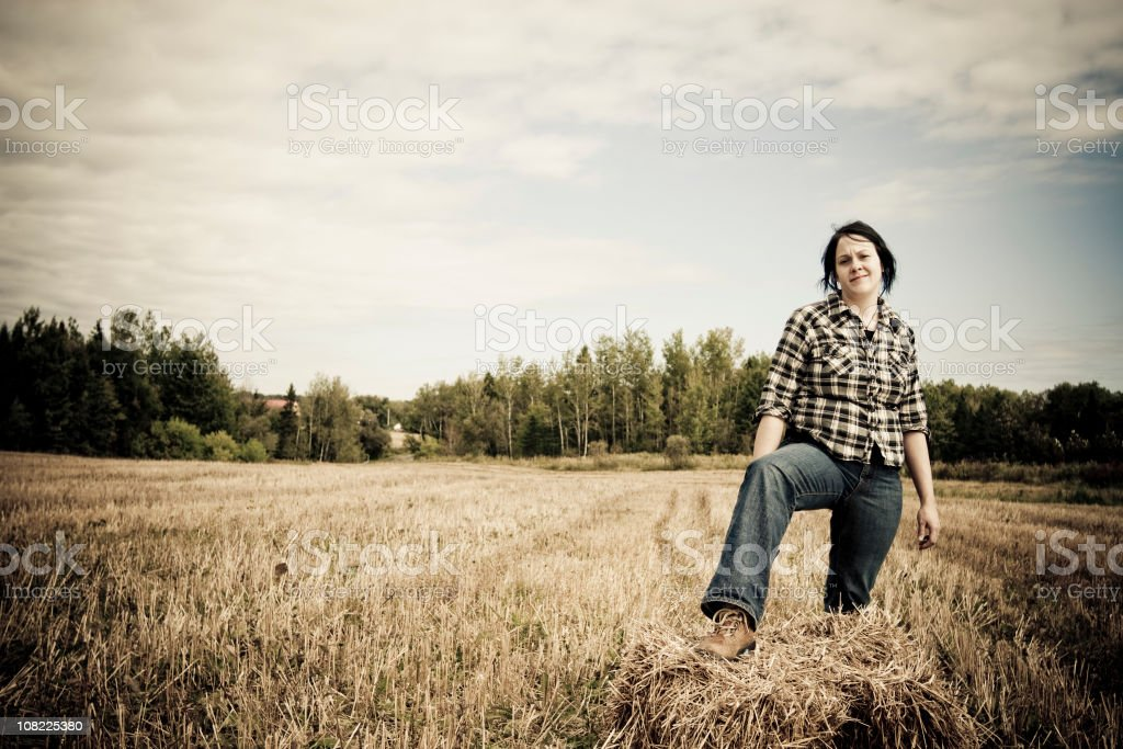 Young Woman Farmer in Field stock photo
