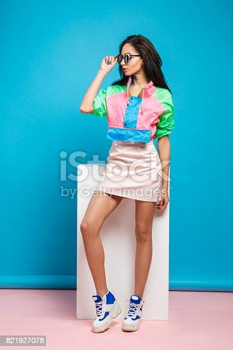 istock Young woman fashion lookbook model studio portrait 821927078