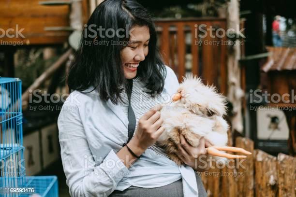 Young woman feeding rabbit at rabbit farm in bandung picture id1169593476?b=1&k=6&m=1169593476&s=612x612&h=ibx 29gtpk ywv7q1iy2uz eebd amy3aco ajgpsck=