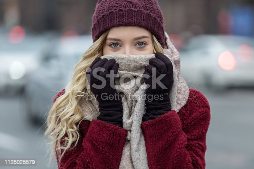 istock Young woman feeling cold in winter 1125025579