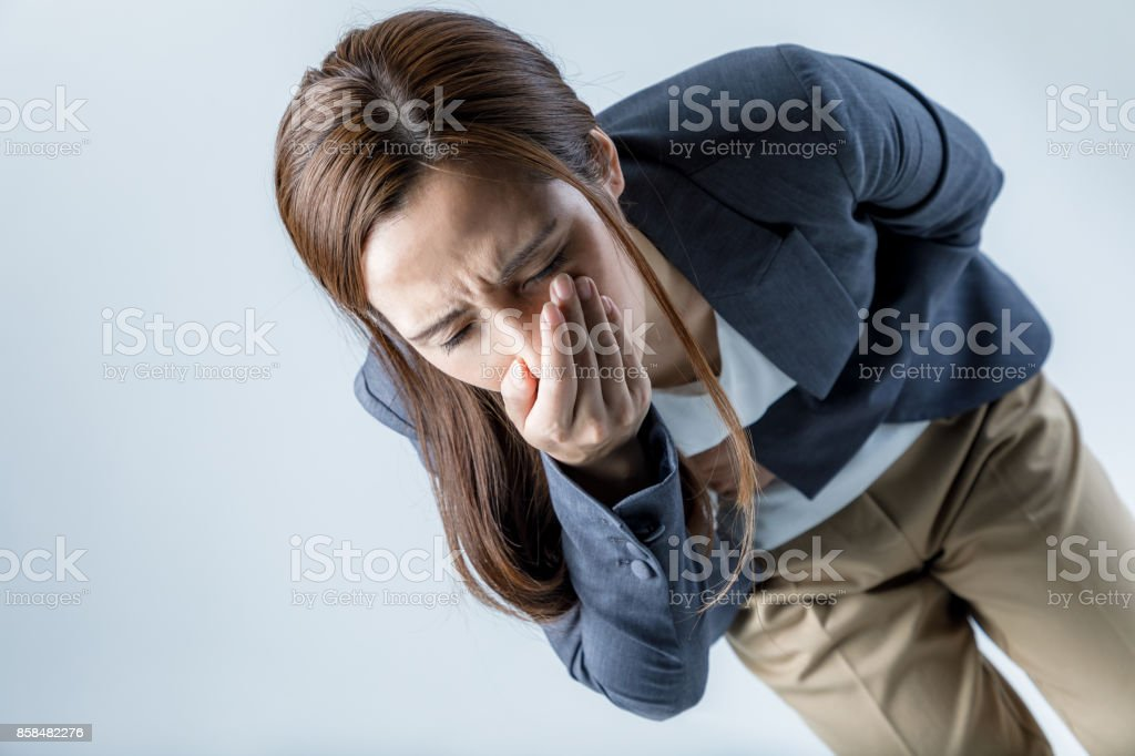 young woman feeling nauseated. stock photo