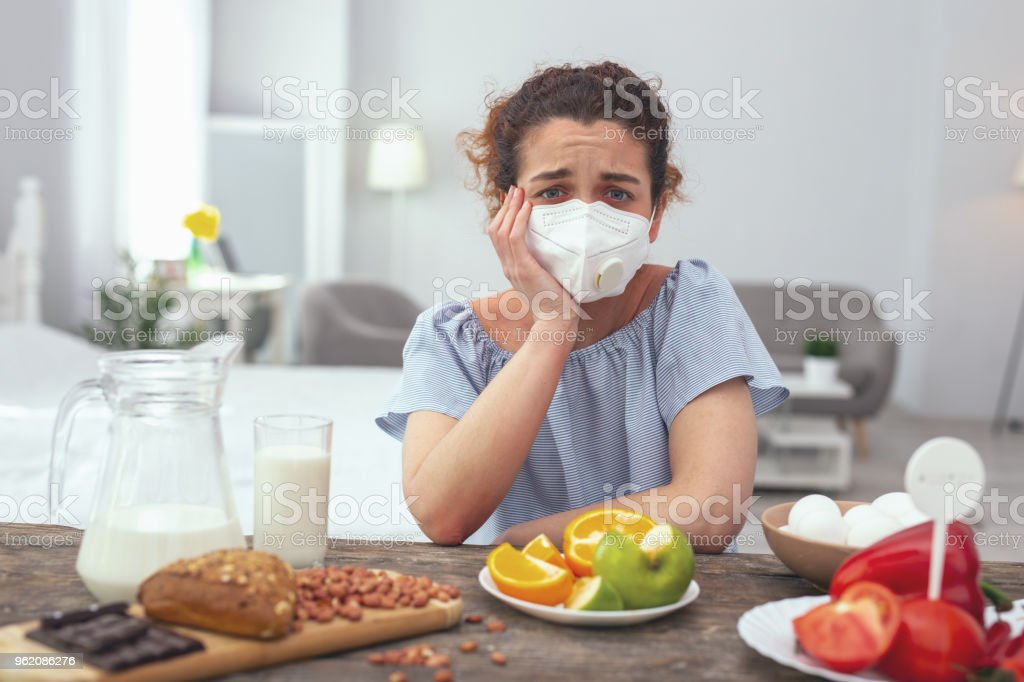 Young woman feeling upset about her multiple allergies stock photo