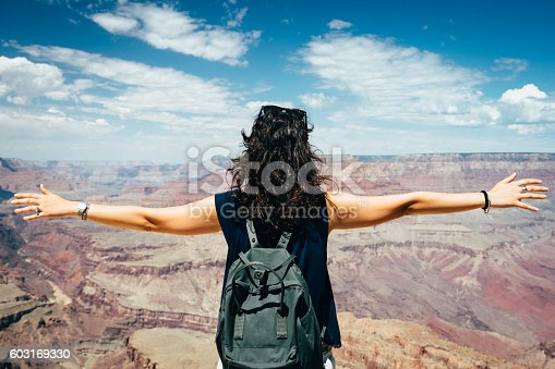 Young Woman Feels Free At Grand Canyon