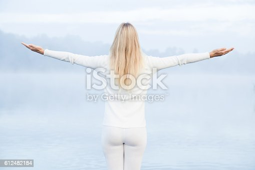 873786782 istock photo Young woman feels the freedom in the mist. Foggy air. 612482184
