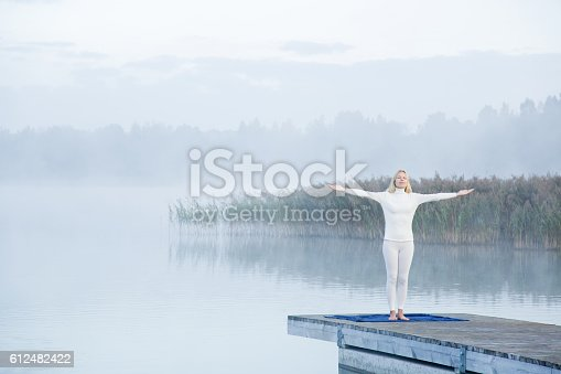 873786782 istock photo Young woman feels the freedom in the mist. Foggy air. 612482422