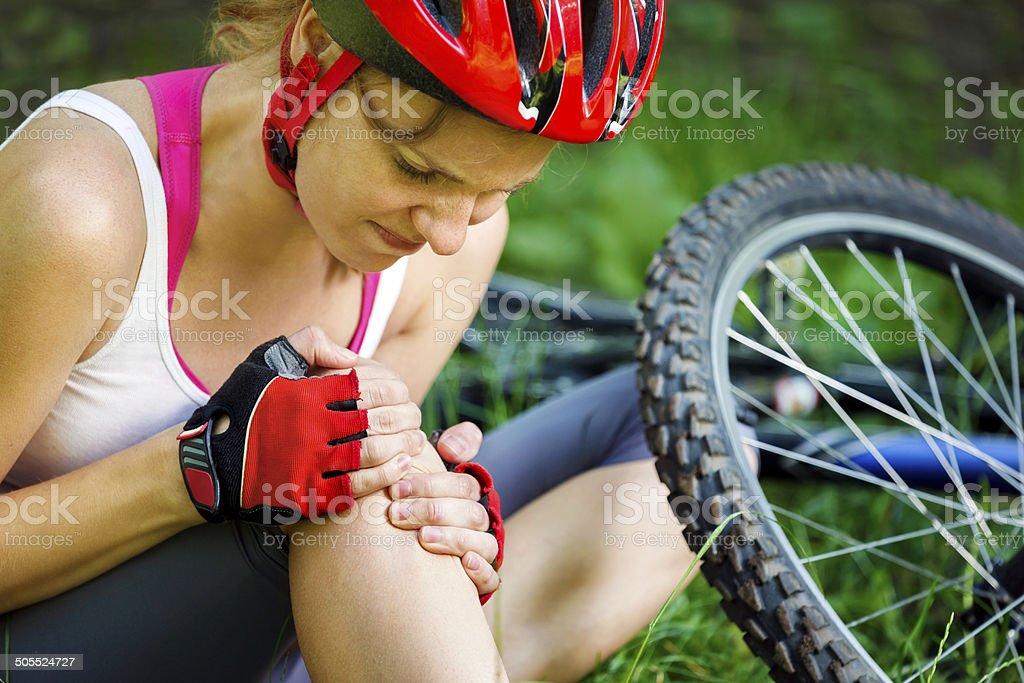 Young woman fell off mountain bike. stock photo