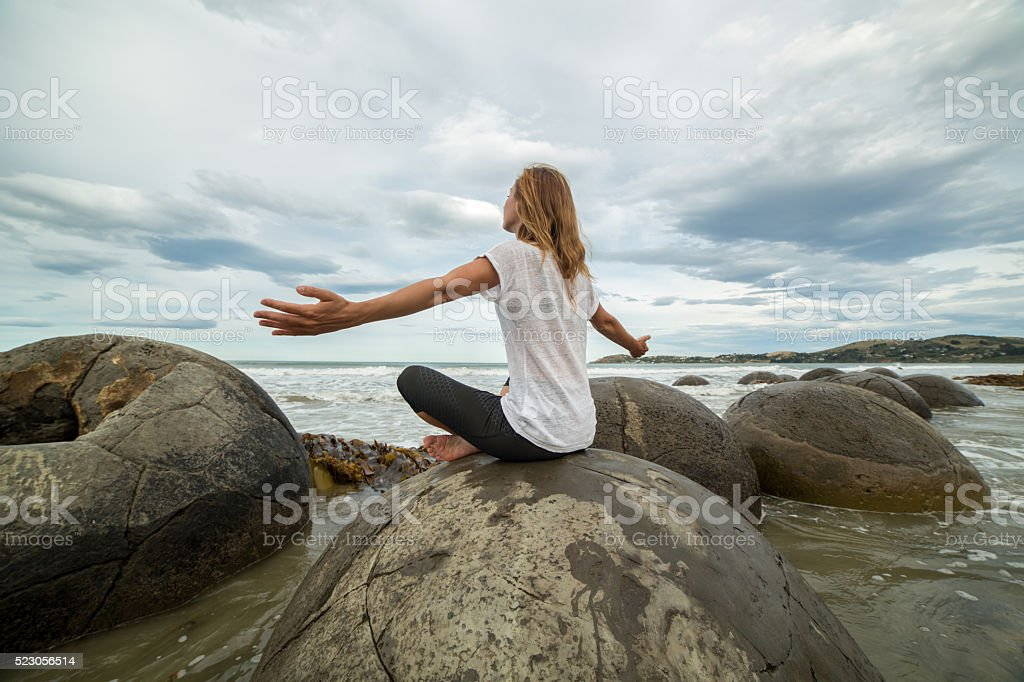 Young woman finds her balance in nature stock photo