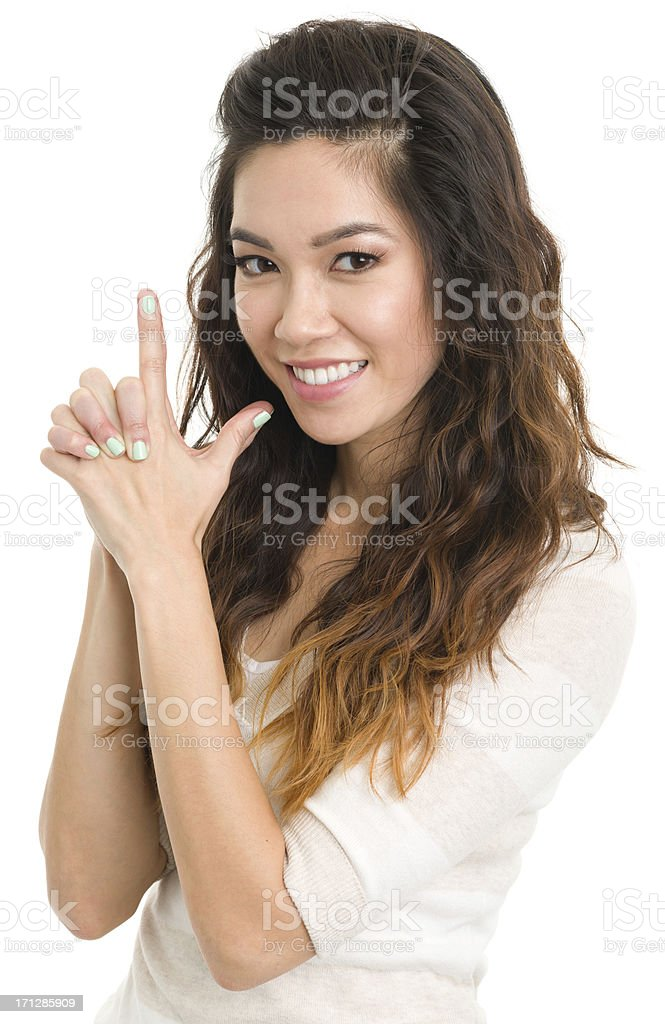 Young Woman Finger Gun Gesture stock photo