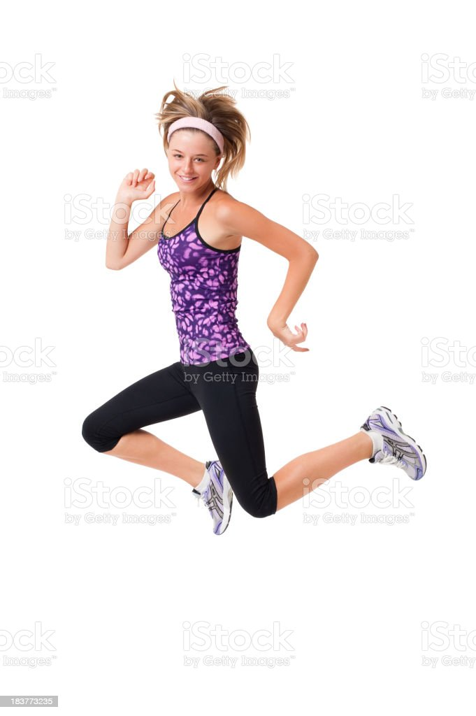 Young Woman Fitness Model Jumping Isolated on White Background royalty-free stock photo