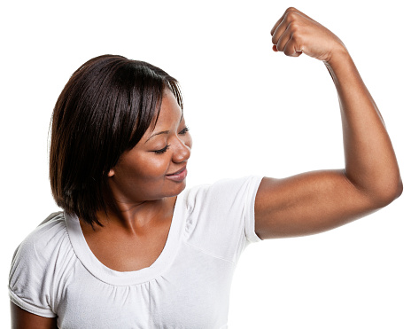 657442382 istock photo Young Woman Flexes Bicep Muscle 183358423