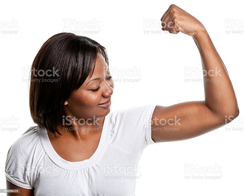 Young Woman Flexes Bicep Muscle stock photo