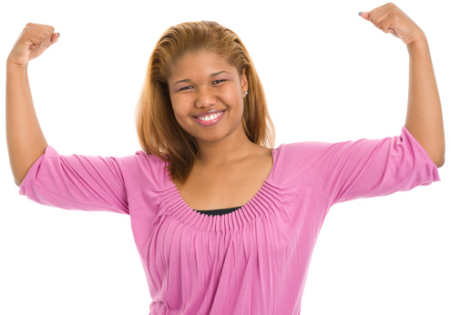 657442382 istock photo Young Woman Flexing Muscles 173250637