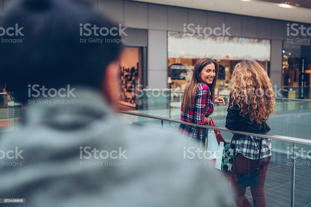 Young woman flirting in the shopping center stock photo