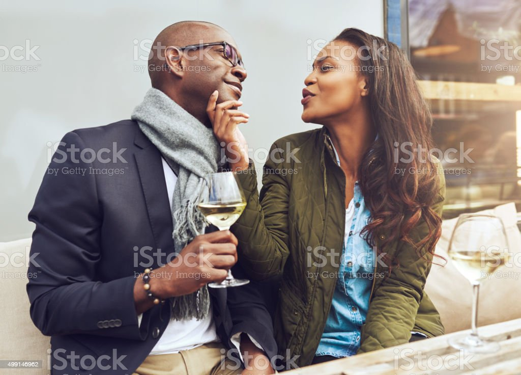Young woman flirting with her boyfriend stock photo