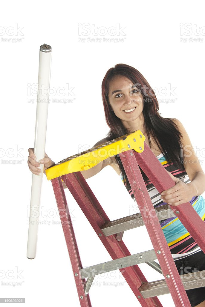 Young woman florescent bulb step ladder royalty-free stock photo