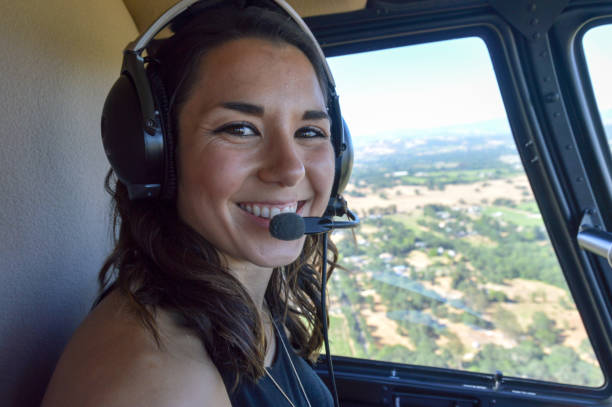 Young woman flying in helicopter stock photo