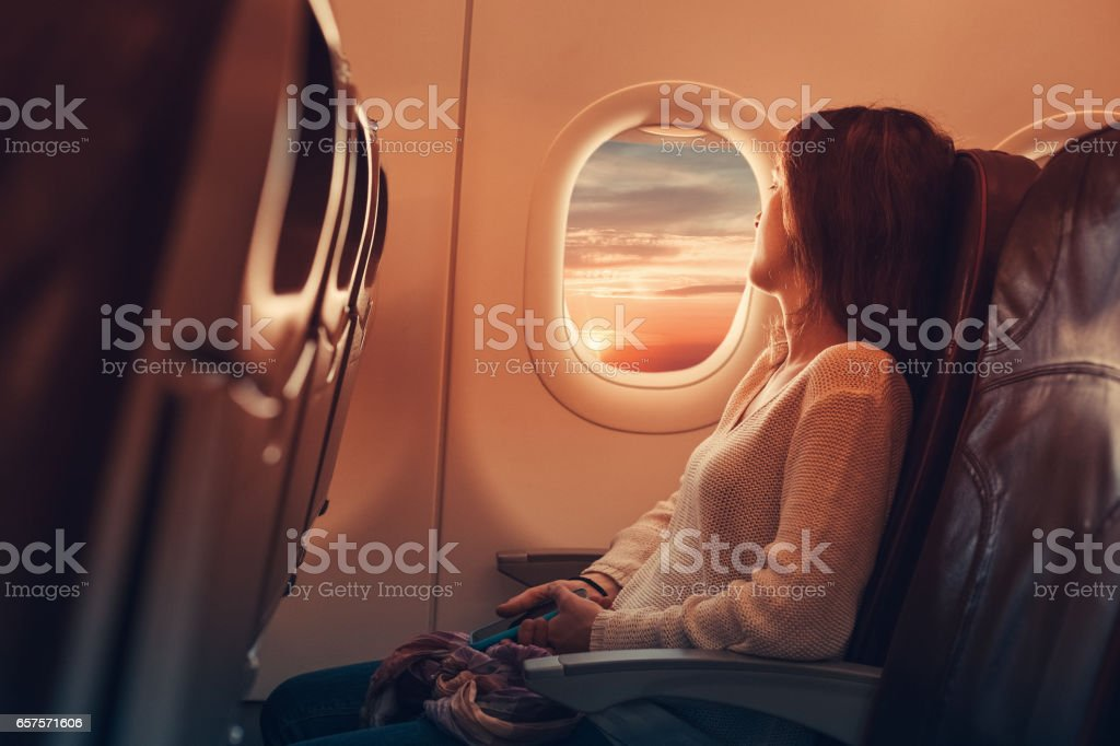 Young woman flying to France stock photo